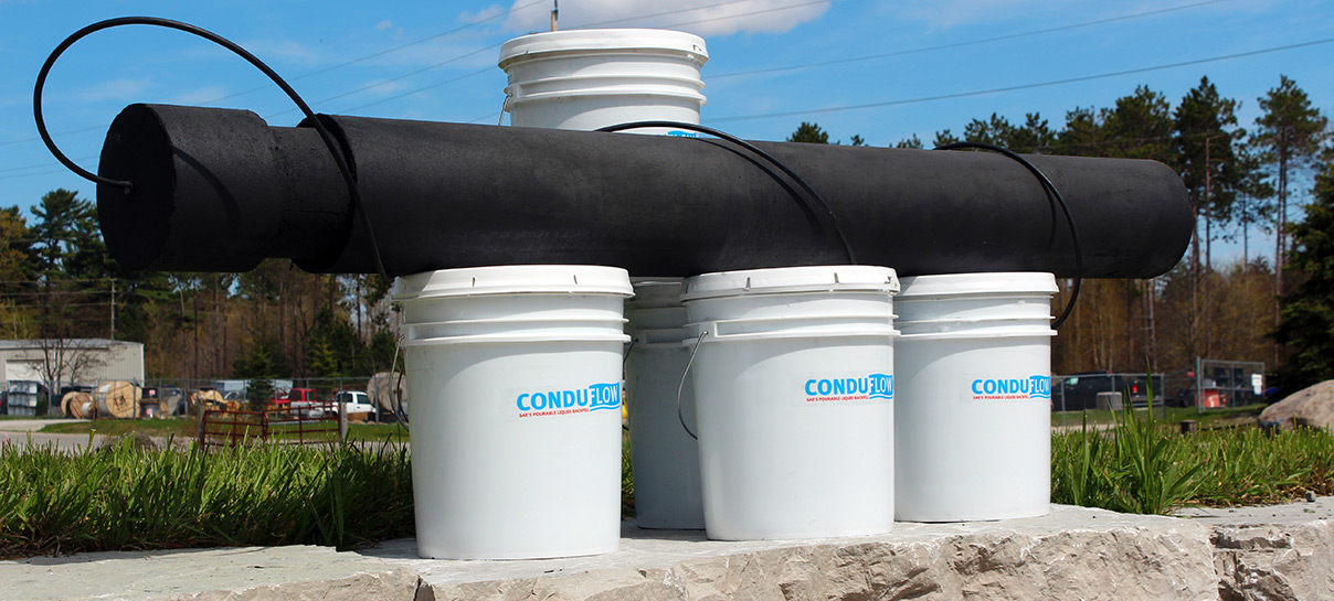 Conduflow in white buckets | SAE Inc.