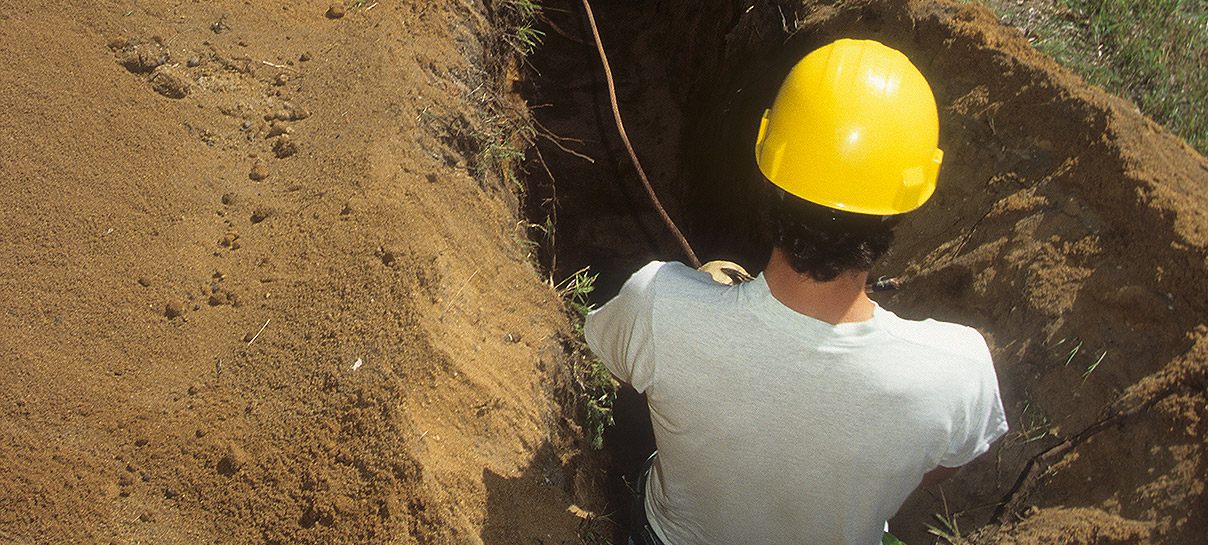 Man working in AC Mitigation Ditch | SAE Inc.